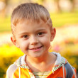 Handsome smiling little boy — Stock Photo