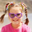 Funny little girl wearing a sunglasses — Stock Photo #41679999