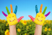 Two smiley hands in sunny summer's day. — Stock Photo