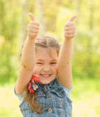 Portrait of happy kid showing thumbs up  — Stock Photo