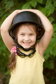 Portrait of smiling child in helmet — Stock Photo