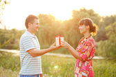 Valentine gift. Happy couple in love together  — Stock Photo