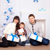 Family with gifts near Christmas tree.  — Stock Photo