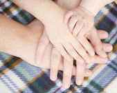 Baby, child, mother, father hands. Family concept — Stock Photo