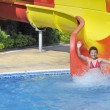 Girl in the pool water slide — Foto Stock