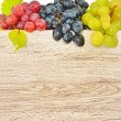 Stock Photo: Types of grapes on wood