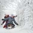 Kids sliding in winter time — Stock Photo