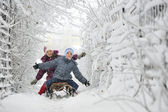 Kids sliding in winter time — Fotografia Stock