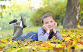 Little girl laying on the grass — Stock Photo