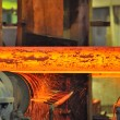 Hot steel on conveyor — Stock Photo #14079170
