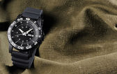 Military watch on sack background — Stock Photo
