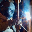Welder working at shipyard — Stock Photo #23196916