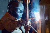 A welder working at shipyard — Stock Photo