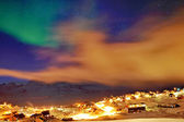 Tasiilaq in mist and northern lights — Stock Photo