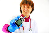 Doctor checking diabetic's blood sugar — Stock Photo