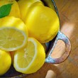 Fresh lemons on a wood table — Stock Photo
