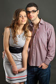 Woman and man with magnetic jewellery shoot in studio — Stock Photo