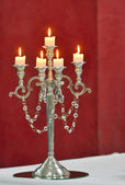 Silver classic candlestick isolated on red — Stock Photo