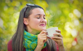 Beautiful Girl enjoy a coffee in Nature — Stock Photo