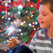 Portrait of boy looking at  fire sparks — Stock Photo