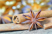 Extremely closeup view of anise star and cinnamon sticks — Stock Photo