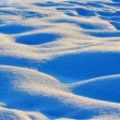 Stock Photo: Waves of snow bumps