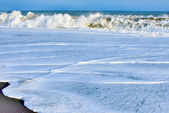 Ocean wave over sand — Stock Photo
