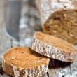 Brown bread on an old wooden table — Stock Photo