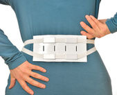 Spine massage belt for hernia pain — Stock Photo