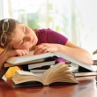 Teenager girl sleeping on books — Stock Photo