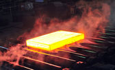 Hot steel sheet on conveyor — Stock Photo