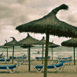 Stock Photo: Beach and sewith sunbeds, umbrellas and