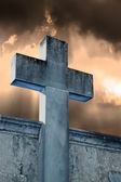 Stone cross in the cemetery — Stock Photo