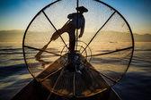 Silhouette fishermen in Inle Lake at sunrise, Shan State, Myanma — Stock Photo