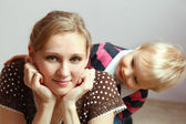 Happy young mother and her son posing together. — Stock Photo
