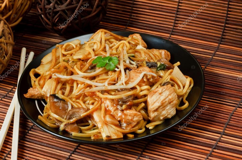 Chicken chow mein a popular chinese food available at take aways  Stock Photo #13053196