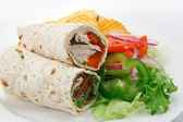 Sliced wraps and salad — Stock Photo