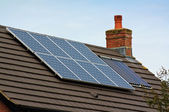 Photovoltaic Solar Panels on a tiled roof — Stock Photo
