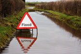 Flood warning sign — Stock Photo