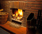 A cosy roaring log fire — Stock Photo