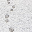 Footprints in the snow background — Stock Photo