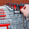 Insert money Supermarket shopping cart — Stock Photo