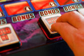 Playing the slots — Stock Photo
