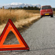 Stock Photo: Broken down car with warning signal