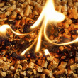 Burning Wood chip biomass fuel a renewable alternative source of - Stock Photo