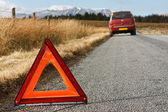 Broken down car with warning signal — Stock Photo