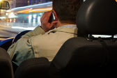 Man using mobile phone while driving — Stock Photo