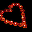 Red tealights in heart shape — Stock Photo