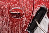 Cleaning the car at jetwash — Stock Photo