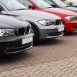 Stock Photo: Line of luxury used cars